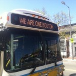 "Bus displaying the message, ""We Are One Boston""."