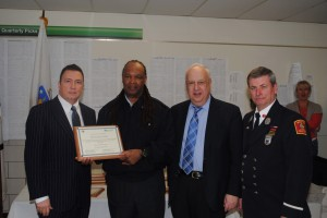 Local 589 member Paul Frazier receiving an award from the MBTA and with a representative form the Boston Fire Department.