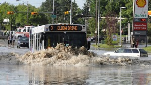 A Calgary transit bus tries to navigate a main road in north Calgary.