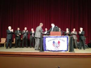 ATU International President Larry Hanley presents an award to Local 618 President Paul Harrington.