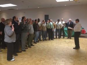 I.V.P. Richard Murphy swears in the new barn captains.