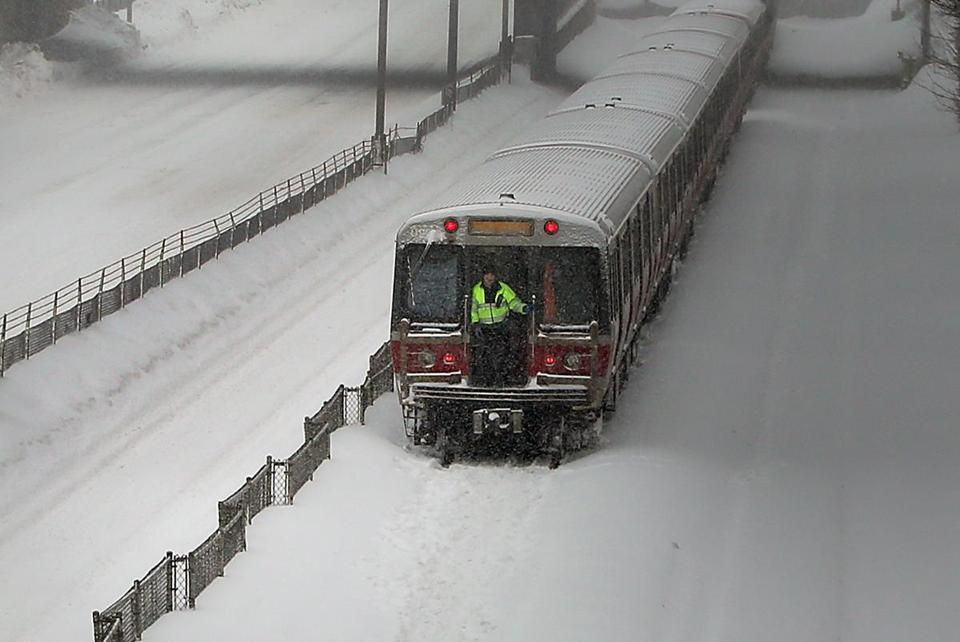 Snow caused a Red Line train to become stuck in Quincy on Monday. Courtesy of the Boston Globe. DAVID L. RYAN/GLOBE STAFF