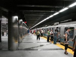 People boarding a Blue Line train.