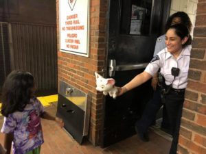 Photo of one of our members returning a lost toy to a little girl.